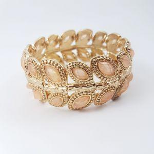 Zlatavý náramek s béžovými kamínky