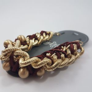 Zlatý náramek s propletený provázkem