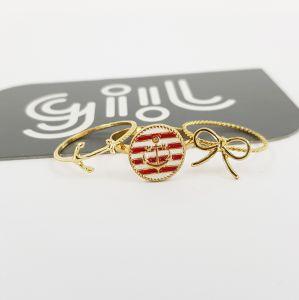 Prsteny zlaté barvy s námořnickými motivy