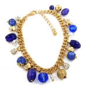 Zlatý náramek s modrými a bílými kamínky