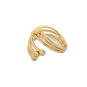 Zlatý stočený prstýnek s kamínky na konec prstu